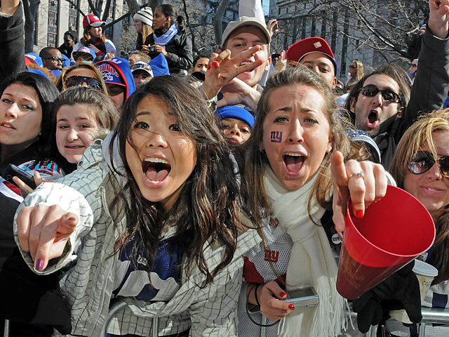 <p>Fans celebrate the Giants Super Bowl victory at the ticker tape parade on Feb. 7, 2012</p>