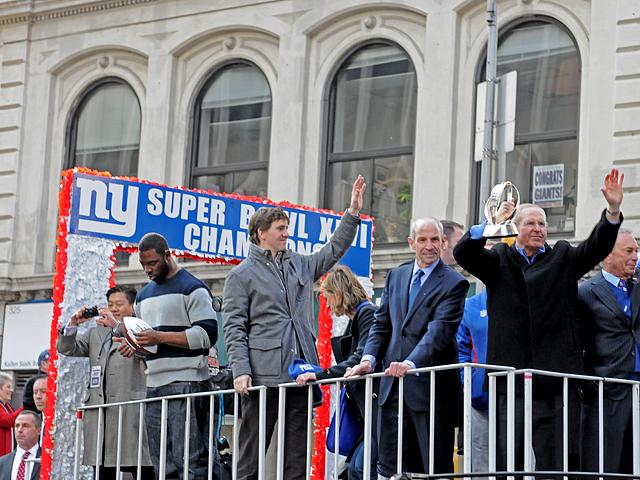 <p>Eli Manning waved to fans from the float for the Giants&#39; ticker tape parade on Feb. 7, 2012.</p>