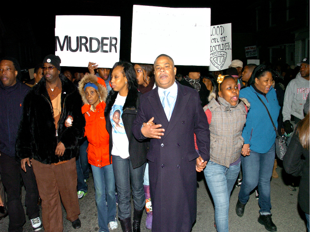 <p>Bronx residents hold up &quot;Murder!&quot; signs while marching to protest the police shooting of 18-year-old Ramarley Graham.</p>