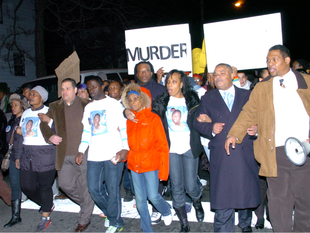 <p>Bronx residents marched arm-and-arm in protest of the police shooting of unarmed teenager Ramarley Graham.</p>