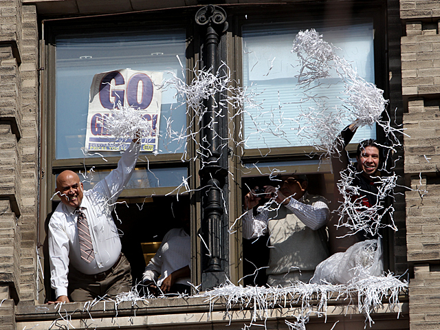 <p>Office workers enjoy the New York Giants ticker tape parade on Feb. 7th, 2012.</p>