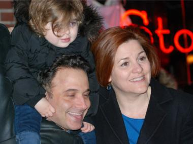 City Council Speaker Christine Quinn poses wih Darren Rosenblum and his daughter, Melina, 2, outside the Stonewall Inn on Tues. Feb. 7, 2012.