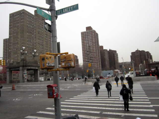Pedestrians cross Delancey Street at Clinton Street, where 12-year-old Dashane Santana was killed Jan. 13, 2012.
