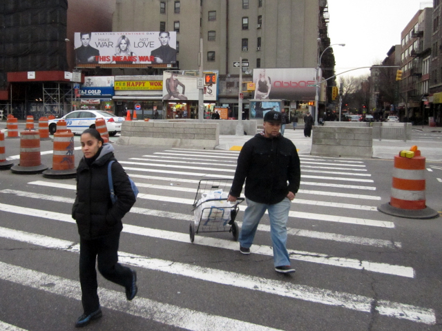 Pedestrians cross Delancey Street at Clinton Street, a crossing that could soon get nearly 50 feet shorter.