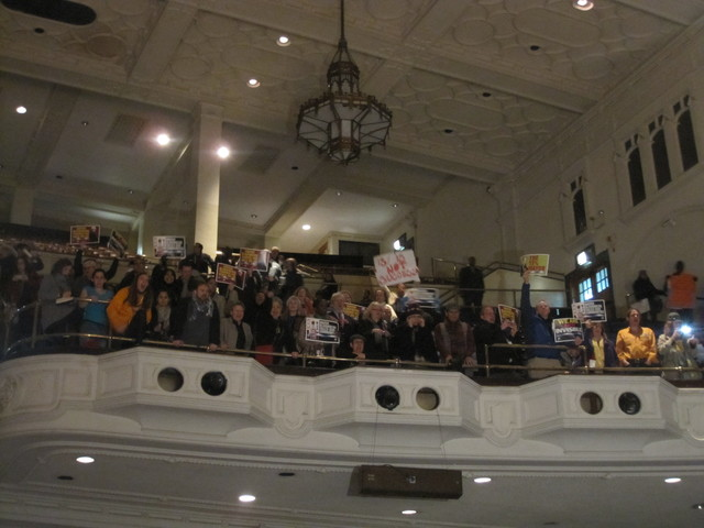 More than 2,000 people packed the room, mostly to express opposition to the closures.