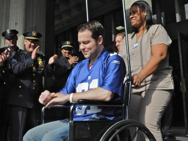 NYPD Officer Kevin Brennan headed home Feb. 10, 2012, after recovering from being shot in Bushwick.