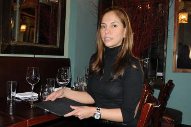 Patricia Valencia, who owns Cafe Cortadito with her husband, holds the iPad  Sanitation worker Michael Maldonado tried to steal on Fri. Feb. 10, 2012, police said.