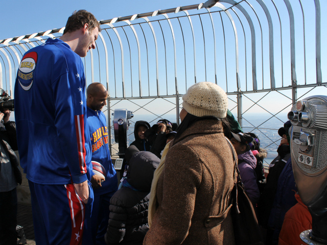 'Flight Time' Lang and 'Tiny' Sturgess greet kids from Garden of Dreams on top of the Empire State Building.