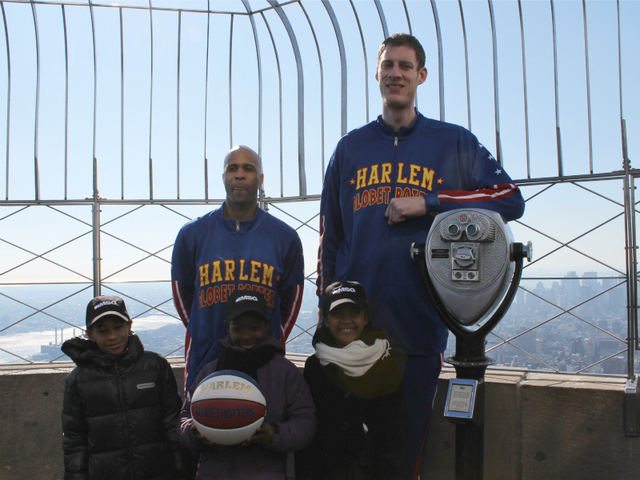 'Flight Time' Lang and 'Tiny' Sturgess pose with kids from Garden of Dreams on top of the Empire State Building.