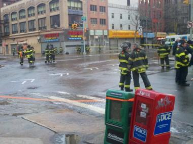 Firefighters worked to get the flood under control at Delancey Street and the Bowery after a main broke on Feb. 14, 2012.