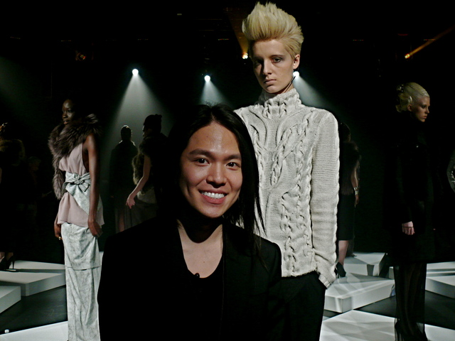Designer Brandon Sun with his ivory cashmere evolution sweater on Alina.