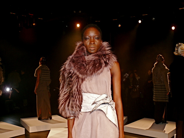 A well-coiled Fatou in dusk rose cashmere gauze tank top and dusk rose SAGA silver fox collar and blizzard cracked leather obi belt.