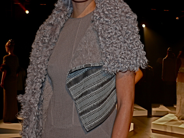 Detail of Amanda in gray shearling stole with reptilian trim.
