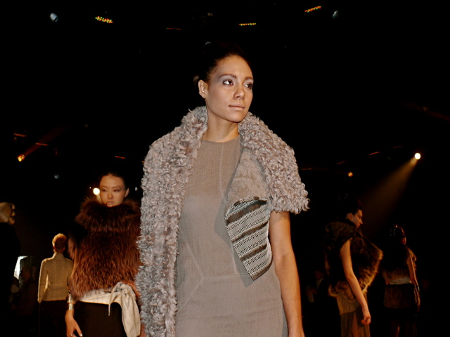 Amanda in cashmere gauze maxi-dress, a storm grey shearling stole with reptilian lace trim.