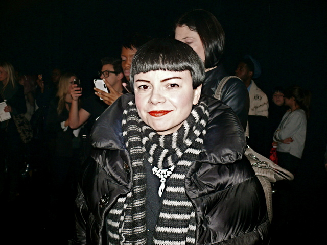 Author and fashion editor Julie Alvarez in her signature black and white look with coiled knits and a Louise Brooks style bob.