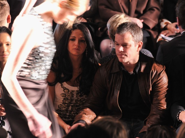 Matt Damon and wife Luciana in the front row of the Naeem Khan presentation at Fashion Week, where a model stepped out of her shoe during the show.