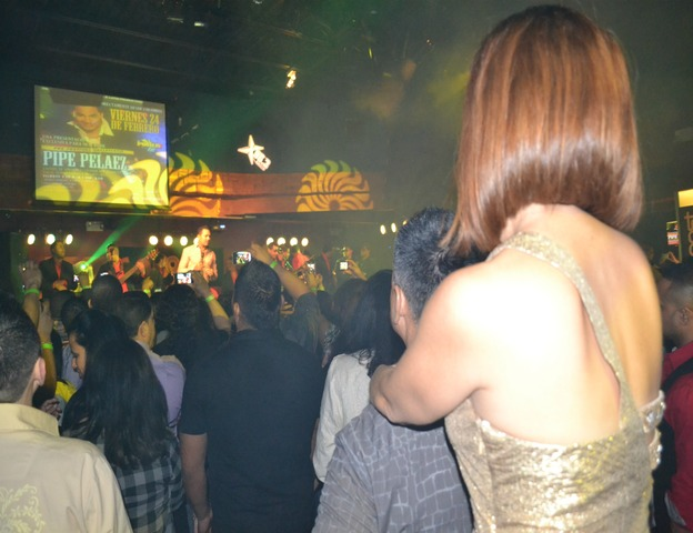 Latino couples watch bachata singer Frank Reyes at La Boom nightclub in Woodside, Queens.