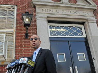 Schools Chancellor Dennis Walcott outside P.S. 174 in Queens. A teacher at the school was arrested on sexual abuse charges.
