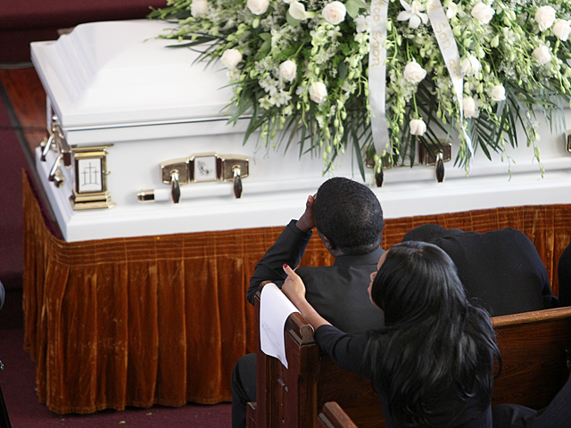 Franclot Graham, the father of slain Bronx teen Ramarley Graham, weeps at his son's funeral service on Sat., Feb. 18, 2012.