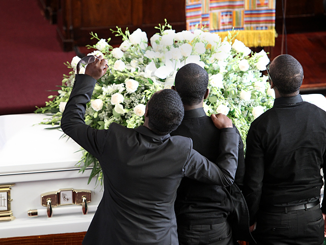 Franclot Graham, the father of slain Bronx teen Ramarley Graham, at his son's funeral on Sat., Feb. 18, 2012.