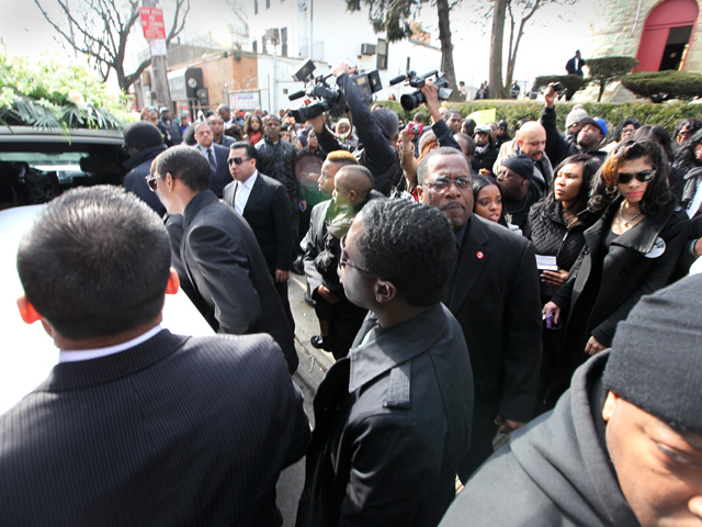 The casket of Bronx teen Ramarley Graham is placed inside a funeral hearse on Sat., Feb. 18, 2012.