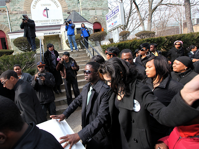 Franclot Graham and family leave the funeral of Ramarley Graham at the Crawford Memorial United Methodist Church on Sat., Feb. 18, 2012.