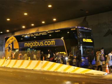 Passengers load onto a bus at the new Megabus hub at Port Authority Bus Terminal on Feb. 16, 2012.