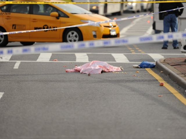 The body of woman who was struck and killed by a city bus lay at the intersection of Northern Blvd. and Union Street.