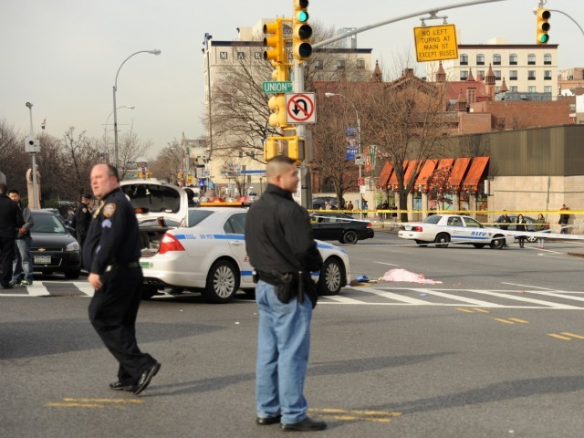 Cops looked in the aftermath of a woman being struck and killed by a city bus in Flushing on Feb. 22, 2012.