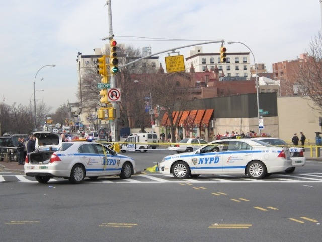 Cops responded to Northern Boulevard and Union Street after a city bus fatally struck a woman on Feb. 22, 2012.