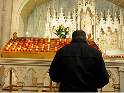A man prays during Ash Wednesday mass at St. Patrick's Cathedral, Feb. 22, 2012.