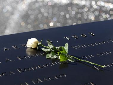 A single white rose is left on top of the names of the six victims of the 1993 bomb attack on the World Trade Center in a ceremony marking the 19th Anniversary on Feb. 26th, 2012.