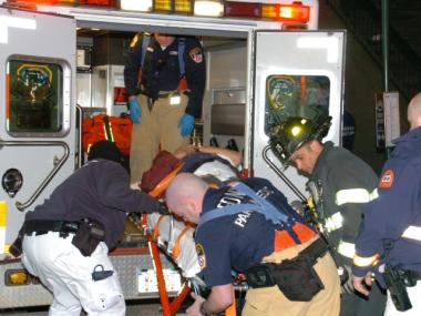 Medics put a man into an ambulance after a homeless man allegedly pushed a straphanger off the platform at the Times Square subway station on Feb. 25, 2012.