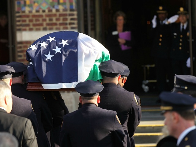 The casket of police officer Peter Figoski is brought into a church during the funeral for the New York City police officer who was killed last week while responding to a robbery at St. Joseph's Church on December 19, 2011 in Babylon, New York.