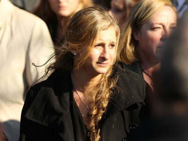 <p>Corrine Figoski, 14, one of the four daughters of murdered NYPD officer Peter Figoski leaves following the funeral at St. Joseph&rsquo;s Church on December 19, 2011 in Babylon, New York.</p>