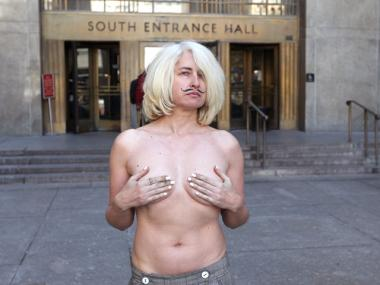 A topless Holly Van Voast, 46, outside Manhattan Supreme Court on Feb. 28th, 2012.