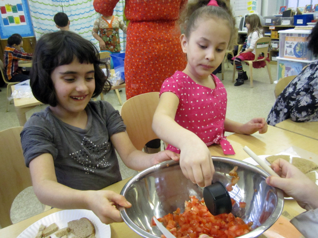 <p>Students at the East Village Community School take part in the Food Bank&#39;s CookShop program, which teaches young chefs about nutritional cooking.</p>