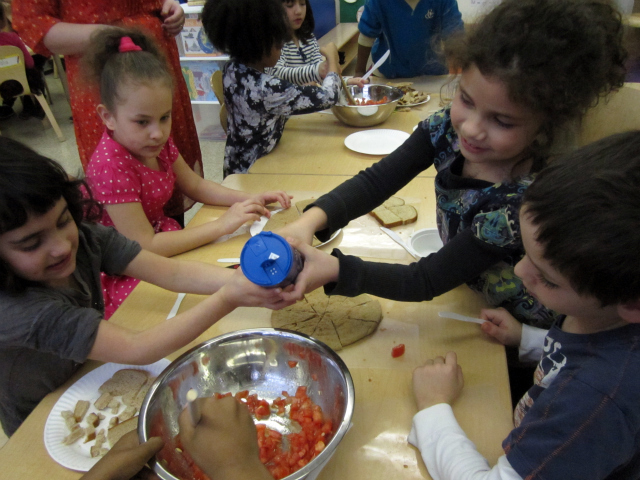 <p>East Village Community School students learn to put just a little bit of salt on their food.</p>