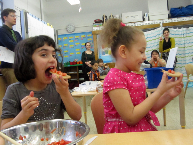 <p>Students taste the healthy version of bruschetta that they made as part of the Food Bank&#39;s CookShop program at the East Village Community School.</p>
