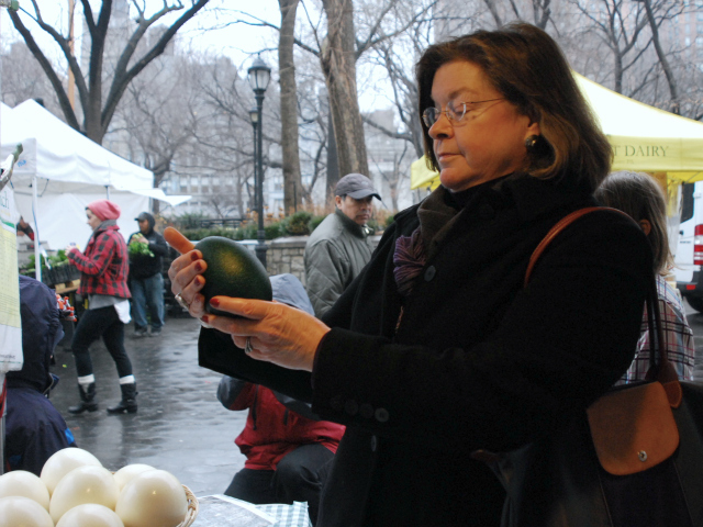 New Jersey resident and artist Grace Palescandolo, 60, enjoys the texture of the black and dark green egg.