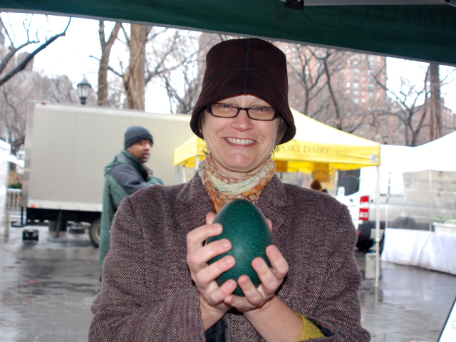 Architect Victoria Rospond, 50, picks up an emu egg to poach for a work luncheon.