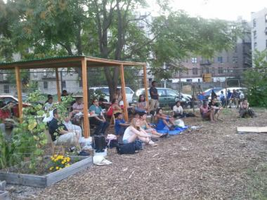 A group of people, several of them students from nearby Samuel Gompers High School, takes advantage of the cleared out space, which gardeners dubbed Morning Glory Community Garden, on an abandoned city lot.
