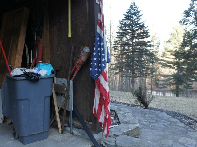 A flag hung on the garage of Anna Gristina's Monroe property.