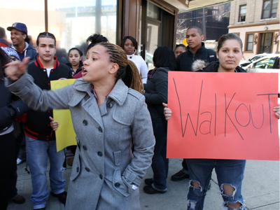 Cheyenne Lee, 18, addresses students from Schomburg Satellite Academy High School during a protest on March 9, 2012. Aiesha Vegas, 17, holds a sign.