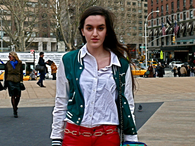Luisa O. in a teal green and white varsity jacket look.