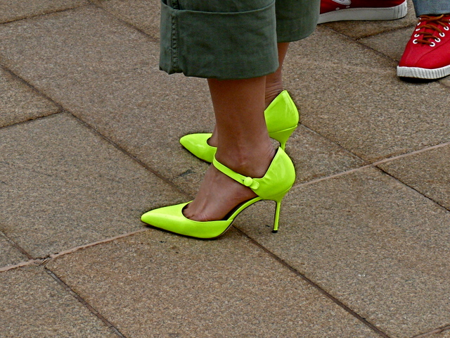 Neon acid apple shoes paired with military green trousers.