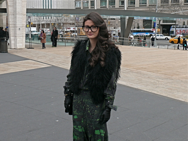 Fashion blogger and street style veteran Peony Lim in a mixed green print dress.