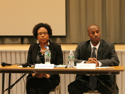 Marsha Vernon, Schomburg's principal, and Colin Thomas, principal of Bronx Regional, listen to speakers at the hearing.