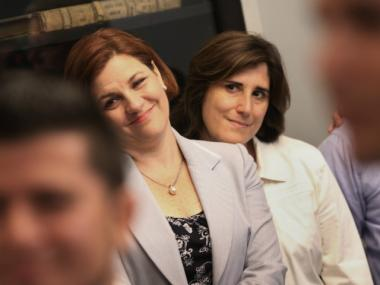 New York City Council Speaker Christine C. Quinn (L) and her partner Kim Catullo, to her right, attend the wedding of Marcos A. Chaljub and Freddy L. Sambrano at the Manhattan City Clerk's office on the first day New York State's Marriage Equality Act goes into effect July 24, 2011 in New York City. Today was the first day gay couples were allowed to legally marry in New York State after Gov. Andrew Cuomo signed the historic legislation into law.