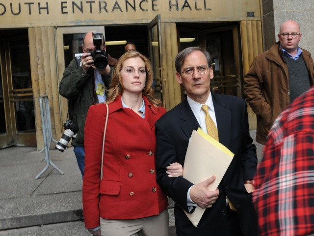 Jaynie Baker leaves Manhattan Supreme Court with her lawyer, Robert Gottlieb, on March 13, 2012 after her arraignment on promoting prostitution charges.